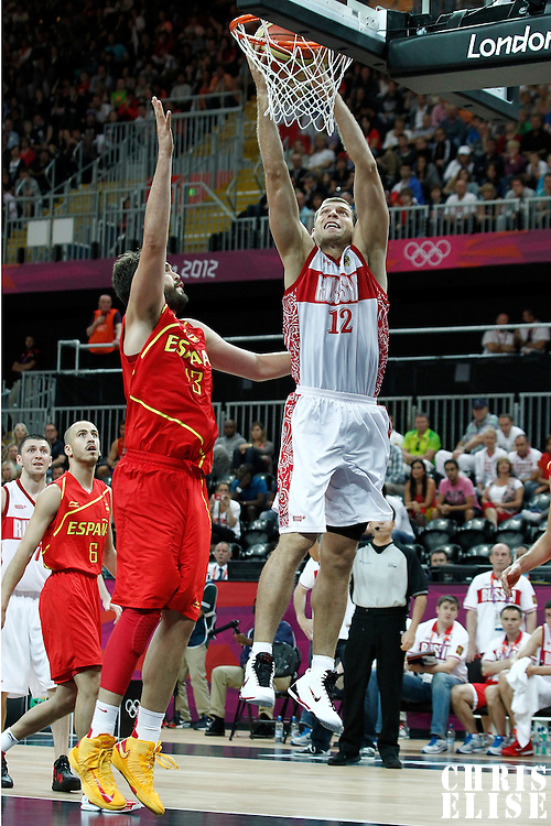 04 August 2012: Russia Sergey Monya dunks the ball over Spain Marc Gasol during 77-74 Team Russia victory over Team Spain, during the men's basketball preliminary, at the Basketball Arena, in London, Great Britain.
