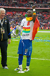 LONDON, ENGLAND - Saturday, May 17, 2008: Portsmouth's Sulley Muntar celebrates with the trophy after their side beat Cardiff City 1-0 during the FA Cup Final at Wembley Stadium. (Photo by David Rawcliffe/Propaganda)