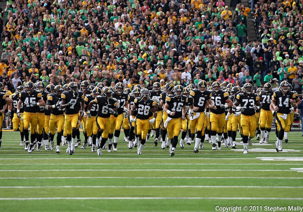 September 24, 2011: The Iowa Hawkeyes run onto the field before the start of the game between the Iowa Hawkeyes and the Louisiana Monroe Warhawks at Kinnick Stadium in Iowa City, Iowa on Saturday, September 24, 2011. Iowa defeated Louisiana Monroe 45-17.