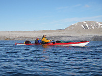 A kayaker passing by outside the Mitra peninsula on Spitzbergen