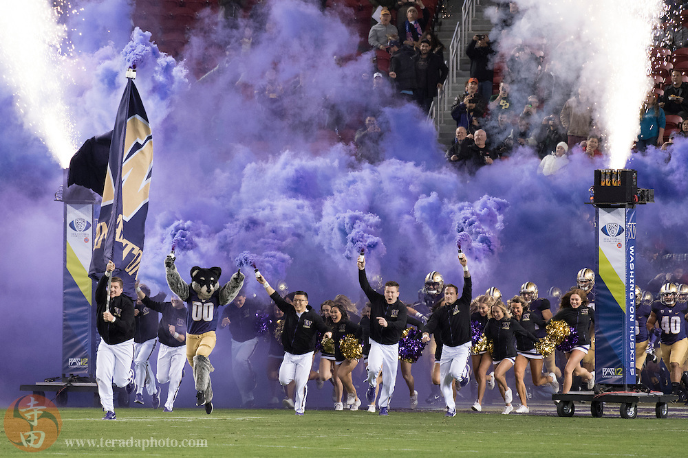 December 2, 2016; Santa Clara, CA, USA; Washington Huskies cheerleaders and mascot lead the team before the Pac-12 championship against the Colorado Buffaloes at Levi's Stadium. The Huskies defeated the Buffaloes 41-10.