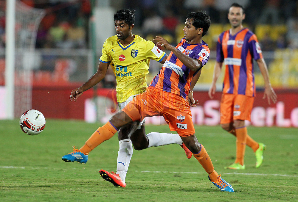 CS Sabeeth of Kerala Blasters FC and Anupam Sarkar of FC Pune City in action during match 17 of the Hero Indian Super League between FC Pune City and Kerala Blasters FC held at the Shree Shiv Chhatrapati Sports Complex Stadium, Pune, India on the 30th October 2014.<br /> <br /> Photo by:  Vipin Pawar/ ISL/ SPORTZPICS