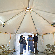 OCTOBER 24 - PONCE, PUERTO RICO - <br /> Medical staff chat inside a temporary hospital tent set up outside the Ponce VA hospital which suffered damage due to the passing of Hurricane Maria.<br /> (Photo by Angel Valentin/Freelance)