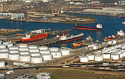 Aerial view of docked tankers and ships at Port of Houston near a tank farm