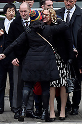 © Licensed to London News Pictures. 08/02/2017. London, UK. CLAIRE BLACKMAN (C), wife of Sergeant Alexander Blackman, is greeted by a well wisher as she arrives at the Royal Courts of Justice in London, where Sgt Blackman has begun an appeal against his life sentence for the murder of a wounded Taliban fighter in Afghanistan in 2011Photo credit: Hannah McKay/LNP