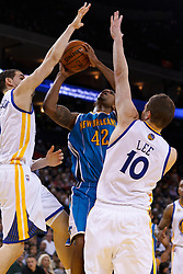 Mar 28, 2012; Oakland, CA, USA;  New Orleans Hornets forward Lance Thomas (42) is fouled by Golden State Warriors guard Klay Thompson (left) during the second quarter at Oracle Arena. Mandatory Credit: Jason O. Watson-US PRESSWIRE