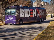 "04 DECEMBER 2019 - AMES, IOWA: Former Vice President Joe Biden's ""No Malarky"" bus drives through the Iowa State University campus after his campaign event in Ames Wednesday. Vice President Biden is touring Iowa this week on his ""No Malarkey"" bus tour. He spoke at Iowa State University in Ames this afternoon. Iowa hosts the first presidential selection event of the 2020 election cycle. The Iowa caucuses are on February 3, 2020.         PHOTO BY JACK KURTZ"