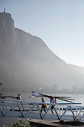 Rio de Janeiro. BRAZIL.  Rio de Janeiro. BRAZIL.  GBR W8+. cox  Zoe DE TOLEDO and coach, Paul THOMPSON [Carrying the blades]  after a training session.2016 Olympic Rowing Regatta. Lagoa Stadium,<br />