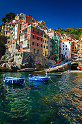 Colorful houses and boats in the harbor, Riomaggiore, Cinque Terre, Liguria, Italy