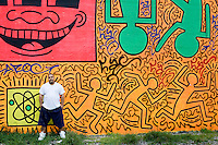 2 August, 2008. New York, NY. Angel Ortiz, 41, a graffiti artist who collaborated with Keith Haring in the 80's, is here in front of the mural he tagged on July 22nd 2008. Angel Ortiz tagged his nickname &quot;LA2&quot;, which refers to &quot;Little Angel&quot;, on the Keith Haring mural that was reproduced on May 4th 2008, after the original 1982 graffiti was painted over. Angel Ortiz asked Clayton Patterson, an artist and gallerist, to help him tag the wall with his own artwork. Mr. Ortiz has accused the Haring Foundation of denying him credit on many of the jointly produced works.  The two artists met in 1980, when Angel Ortiz was 13 years old. Subsequently, Ortiz and Haring collaborated for several years and had joint shows. <br />  &copy;2008 Gianni Cipriano for The New York Times<br /> cell. +1 646 465 2168 (USA)<br /> cell. +1 328 567 7923 (Italy)<br /> gianni@giannicipriano.com<br /> www.giannicipriano.com