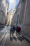 Lunchtime City workers on Lothbury Street in the City of London, the capital's financial district and oldest quarter.