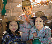 Burmese  girls with Thanaka Root (Myanmar Face Paint ) which has numerous health benefits including: tightening of the skin, anti-septic and natural sunblock, Burma (Myanmar).
