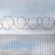 France, Calais. Last days of 'The Jungle'. Security fence and razor wire at Frethun station, Calais.
