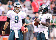 Sept. 23, 2012; Glendale, AZ, USA; Philadelphia Eagles quarterback Nick Foles (9) and quarterback Michael Vick (7) react on the field at University of Phoenix Stadium. The Cardinals defeated the Eagles 27 - 6. Mandatory Credit: Jennifer Stewart-US PRESSWIRE.