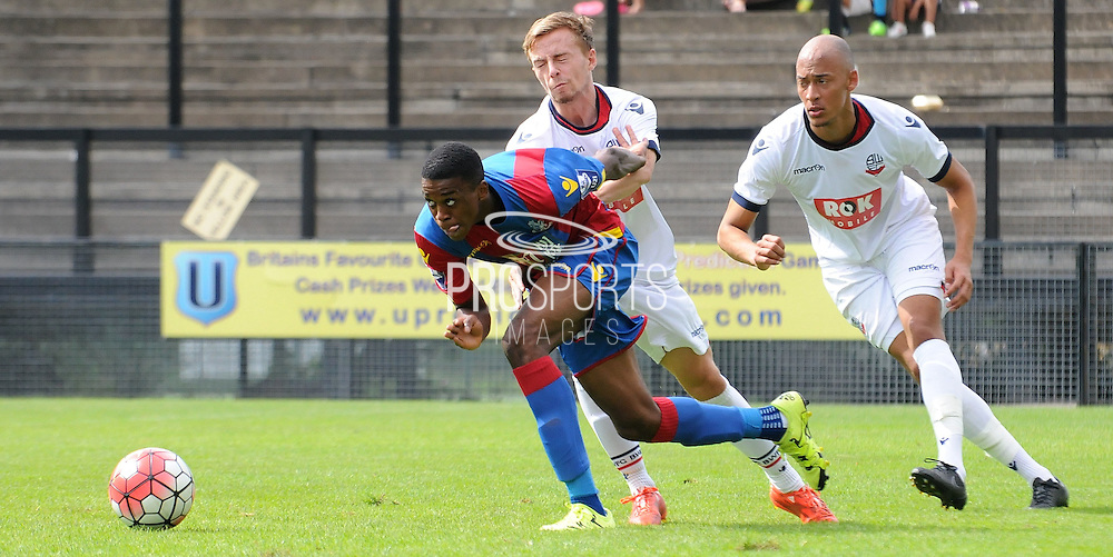 Aaron Bissaka breaking through Bolton's defence during the U21 Professional Development League match between U21 Crystal Palace and U21 Bolton Wanderers at Selhurst Park, London, England on 17 August 2015. Photo by Michael Hulf.