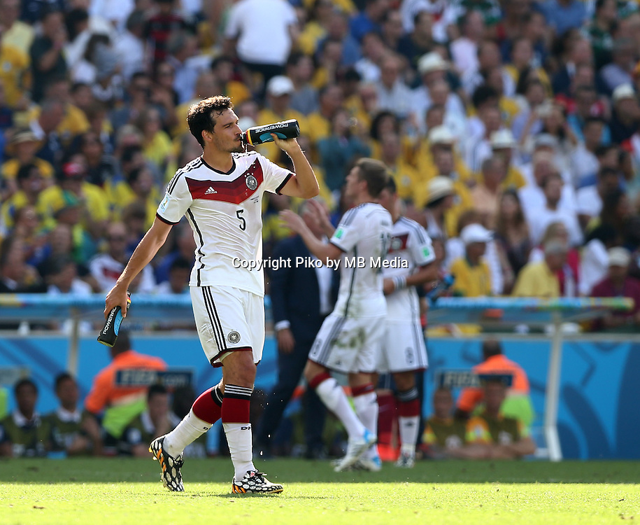 Fifa Soccer World Cup - Brazil 2014 - <br /> FRANCE (FRA) Vs. GERMANY (GER) - Quarter-finals - Estadio do MaracanaRio De Janeiro -- Brazil (BRA) - 04 July 2014 <br /> Here German player Mats HUMMELS refreshing during the match<br /> &copy; PikoPress
