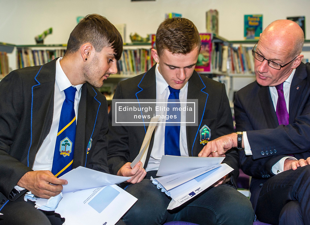 Pictured: Nairn Ross and Callum  Brown compare results with Mr Swinney<br /> <br /> Education Secretary  John Swinney visited Firrhill School today and met students and parents as the results wer available for opening.<br /> <br /> <br /> Ger Harley   EEm 7 August 2018