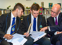 Pictured: Nairn Ross and Callum  Brown compare results with Mr Swinney<br /> <br /> Education Secretary  John Swinney visited Firrhill School today and met students and parents as the results wer available for opening.<br /> <br /> <br /> Ger Harley | EEm 7 August 2018