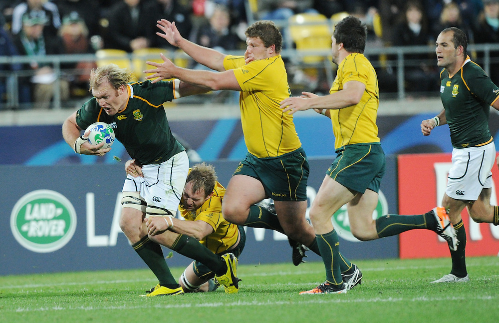 South Africa's Schalk Burger fends off the Australian defence in the Rugby World Cup quarter final match at Wellington Stadium, Wellington, New Zealand, Sunday, October 09, 2011. Credit:SNPA / Ross Setford