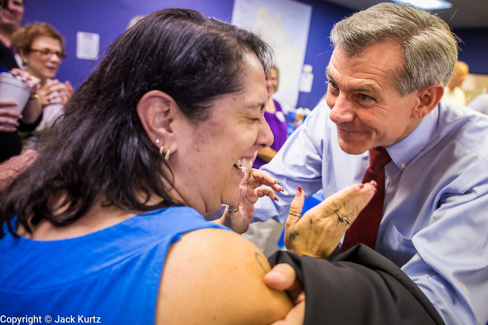 28 AUGUST 2012 - PHOENIX, AZ:    BRANDY BARON, a David Schweikert volunteer, greets Rep DAVID SCHWEIKERT (R-AZ), right, at Schweikert's victory party Tuesday. Schweikert faced Congressman Ben Quayle in what was the most contested Republican primary election in Arizona in 2012. Both were incumbent Republican freshmen elected to Congress from neighboring districts in 2010. They ended up in the same district at the end of the redistricting process and faced off against each other in the primary to represent Arizona's 6th Congressional District, which is made up of Scottsdale, Paradise Valley and parts of Phoenix. The district is solidly Republican and the winner of the primary is widely expected to win November's general election. Both are conservative Republicans with Tea Party backing.   PHOTO BY JACK KURTZ