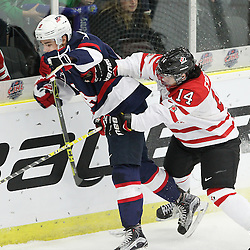 COBOURG, - Dec 15, 2015 -  Game #5 - Canada West vs the United States at the 2015 World Junior A Challenge at the Cobourg Community Centre, ON. Justin Fregona #14 of Team Canada West makes the hit on Mitch Reinke #8 of Team United States during the first period.(Photo: Tim Bates / OJHL Images)