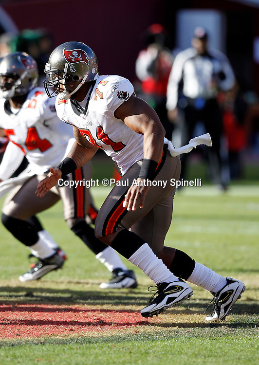 Tampa Bay Buccaneers defensive lineman Michael Bennett (71) rushes the quarterback during the NFL week 11 football game against the San Francisco 49ers on Sunday, November 21, 2010 in San Francisco, California. The Bucs won the game 21-0. (©Paul Anthony Spinelli)