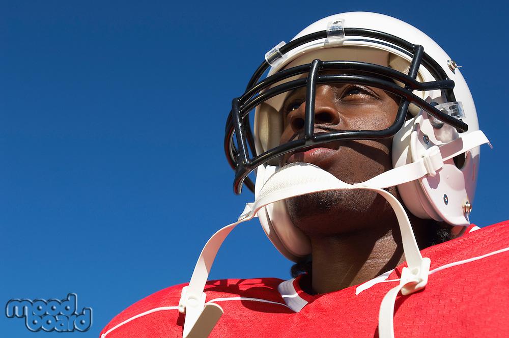 Football Player wearing helmet on outside low angle view close-up (close-up) (low angle view)