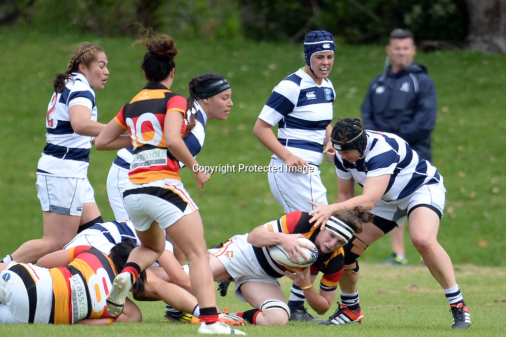 Waikato's Racqual Anderson tries to avoid a tackle during the Women's Rugby NPC Semi Final, Auckland Storm v Waikato. Auckland, New Zealand on Saturday 10 October 2015. Copyright Photo: Raghavan Venugopal / www.photosport.nz
