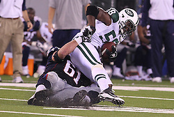 Sept 19, 2011; East Rutherford, NJ, USA; New England Patriots guard Stephen Neal (61) tackles New York Jets linebacker Bryan Thomas (58) after Thomas recovered a fumble by New England Patriots quarterback Tom Brady (12) during the 2nd half at the New Meadowlands Stadium.  The Jets defeated the Patriots 28-14.