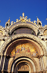 Venice, Italy:  Golden mosaics highlight the main entrance to Basilica di San Marco in St. Mark's Square.