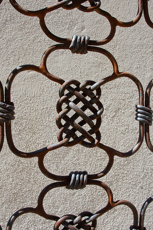 Detail of an iron gate at the Centro Académico y Cultural San Pablo, Oaxaca, Mexico