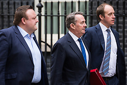 London, UK. 4th December, 2018. Liam Fox MP (c, Secretary of State for International Trade and President of the Board of Trade, arrives at 10 Downing Street for a further meeting following a Cabinet meeting on the day on which MPs will begin to debate Prime Minister Theresa May's Brexit agreement in the House of Commons.