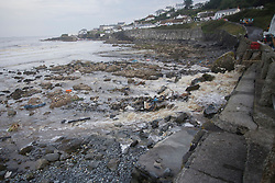 © Licensed to London News Pictures. 18/07/2017. Coverack, UK.  Debris on beach after flash floods hit Cornish village of Coverack this afternoon after heavy rainfall.  Photo credit: Ashley Hugo/LNP