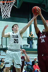 17 November 2017:  Alex O'Neill and Kevin Gamble reach for a rebound during an College men's division 3 CCIW basketball game between the Alma Scots and the Illinois Wesleyan Titans in Shirk Center, Bloomington IL