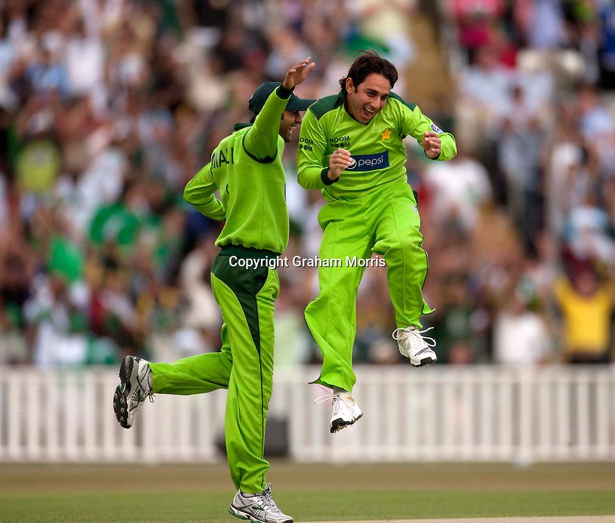 David Warner is bowled by Saeed Ajmal (celebrates on right with Shoaib Malik) during the first International T20 match between Australia and Pakistan at Edgbaston, Birmingham.  Photo: Graham Morris (Tel: +44(0)20 8969 4192 Email: sales@cricketpix.com) 05/07/10