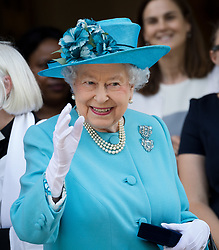 © Licensed to London News Pictures. 15/06/2017. LONDON, UK.  Queen Elizabeth II accompanied by the Duke of Edinburgh, visits Poplar in Tower Hamlets, east London to attend commemorations for the centenary of the bombing of Upper North Street School during the First World War.  Photo credit: Vickie Flores/LNP