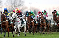 A general view of the runners and riders competing in the Racing TV Free For A Month Juvenile Hurdle during Midlands Raceday at Warwick Racecourse.