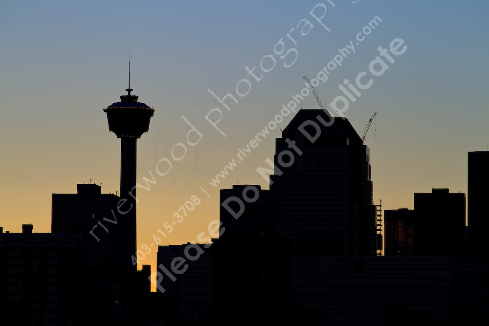 The unmistakable shape of the Calgary Tower stands out against the golden sky during the magic hour just after the sunset.<br /> <br /> ©2010, Sean Phillips<br /> http://www.Sean-Phillips.com
