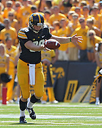 August 31 2013: Iowa Hawkeyes punter Connor Kornbrath (98) punts the ball away during the first quarter of the NCAA football game between the Northern Illinois Huskies and the Iowa Hawkeyes at Kinnick Stadium in Iowa City, Iowa on August 31, 2013. Northern Illinois defeated Iowa 30-27.