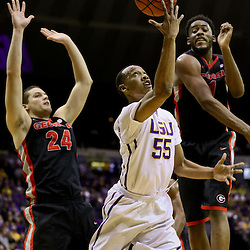 Jan 26, 2016; Baton Rouge, LA, USA; LSU Tigers guard Tim Quarterman (55) shoots over Georgia Bulldogs guard Charles Mann (4) and forward Houston Kessler (24) during the first half of a game at the Pete Maravich Assembly Center. Mandatory Credit: Derick E. Hingle-USA TODAY Sports