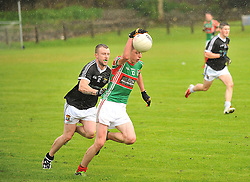 Ballina's Bengi O'Hora gets past Kilmeena's Ronan Keane during the junior Championship play-off in Islandeady on sunday last.<br /> Pic Conor McKeown