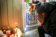 Lathan Goumas - lgoumas@shawmedia.com<br /> <br /> Kyle Smith prays following a vigil for Mohammad Y. Eid outside the Gardner Food Mart, Tuesday Jan. 20, 2015, in Joliet Ill. &quot;Ever since the day I met him he's been my best friend,&quot; Smith said.