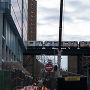 March 8, 2017 - New York, NY : Columbia University's Manhattanville campus is rising on a 17-acre site in West Harlem, north of Columbia's Morningside Heights campus.  A No. 1 train passes the Renzo Piano-designed Jerome L. Greene Science Center, left, and what will eventually become the new University Forum and Academic Conference Center, right, on Wedneday morning.  CREDIT: Karsten Moran for The New York Times