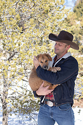 cowboy and an adorable puppy outdoors