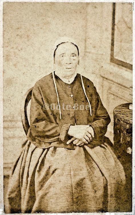 vintage studio portrait of sitting woman