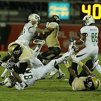 South Florida Bulls wide receiver Derrick Hopkins (87) gets tackled after an attempted catch, by UCF Knights linebacker Terrance Plummer (41) during an NCAA football game between the South Florida Bulls and the 17th ranked University of Central Florida Knights at Bright House Networks Stadium on Friday, November 29, 2013 in Orlando, Florida. (AP Photo/Alex Menendez)