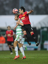 Manchester United's Radamel Falcao Garcia battles for the high ball with battles for the high ball with Yeovil Town's Sam Foley  - Photo mandatory by-line: Joe meredith/JMP - Mobile: 07966 386802 - 04/01/2015 - SPORT - football - Yeovil - Huish Park - Yeovil Town v Manchester United - FA Cup - Third Round