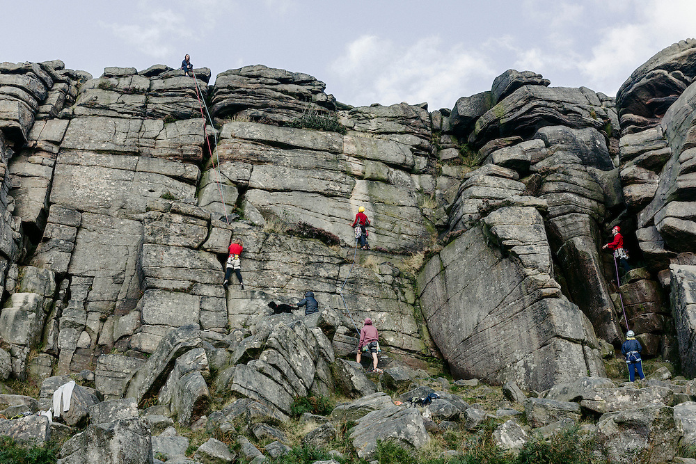 Rock climbers at Stanage Edge.