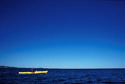 Acadia NP, ME. Sea Kayaking Mt. Desert Island.  Big blue sky over the Atlantic Ocean.