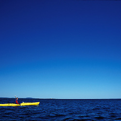 Acadia NP, ME. Sea Kayaking Mt. Desert Island.  Big blue sky over the Atlantic Ocean.